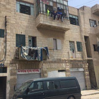 عمارة تجاري قديم جبل عمان شارع خرفان 2محل2شقة تجاري سكن ج مساحتها 231م مؤجرة